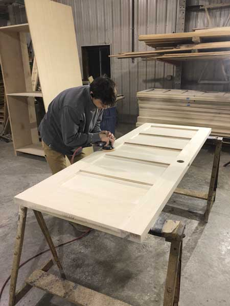 man working in woodworking shop
